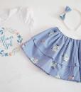 Детски комплект от пола и блуза с цветя в синьо